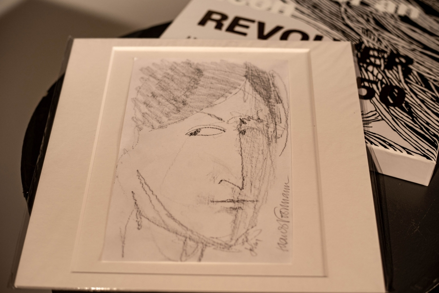 A pen and ink portrait of John Lennon by Klaus Voorman
