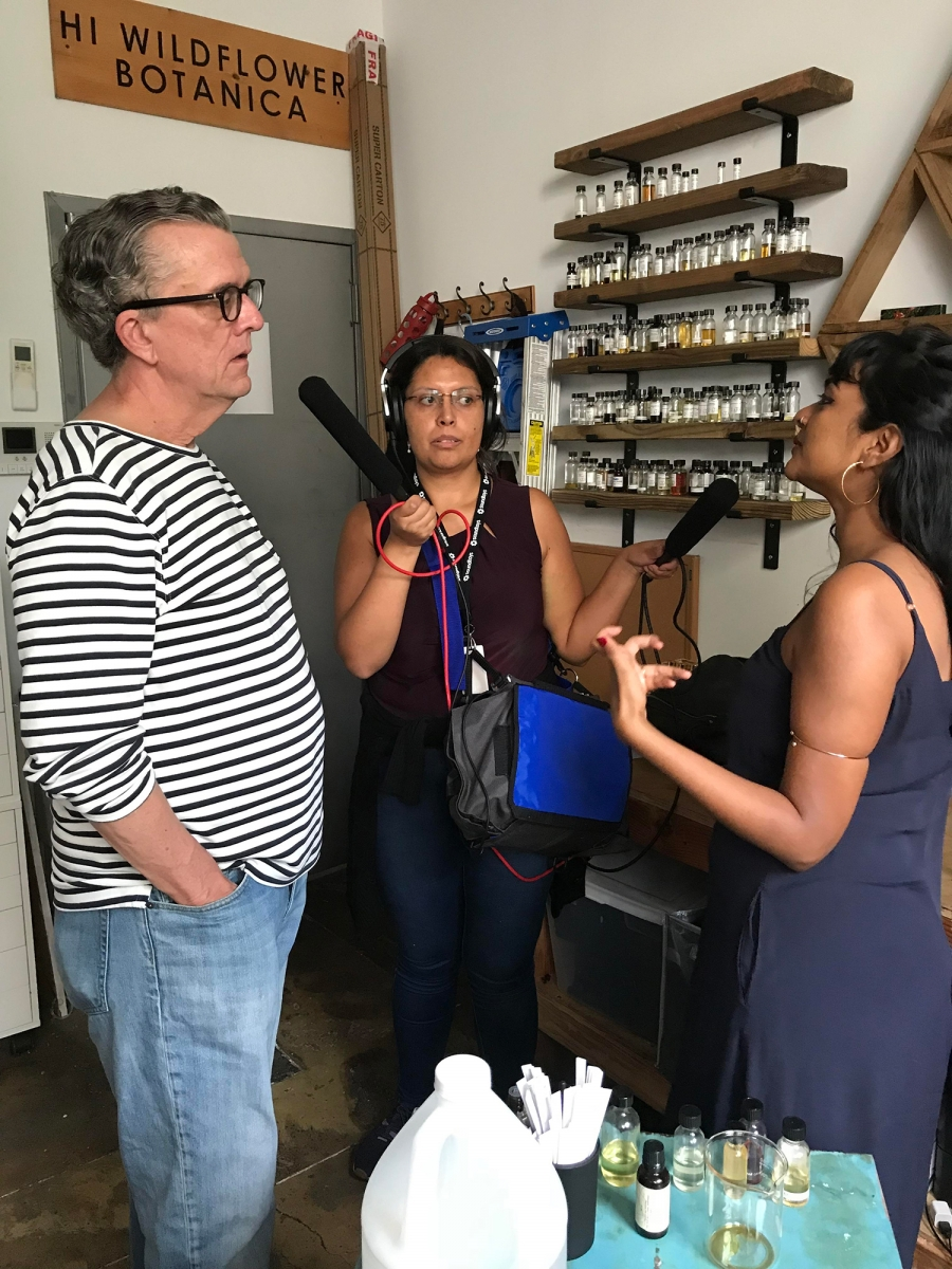 Studio 360 host Kurt Andersen, sound engineer Sandra Lopez-Monsalve and Tanwi Nandini Islam talk at Islam's Hi Wildflower studio.