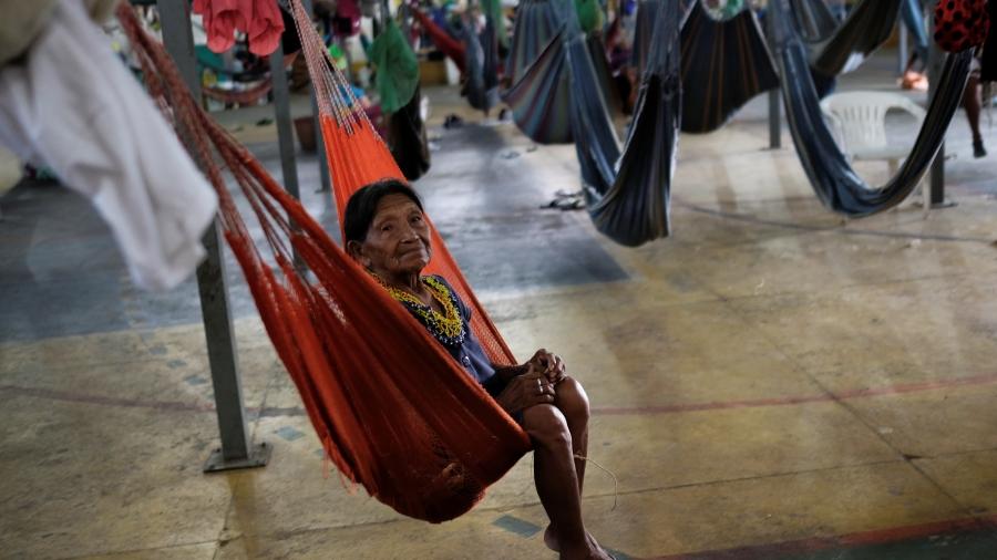 An indigenous Warao woman from Venezuela swings in a hammock at a shelter in Brazil