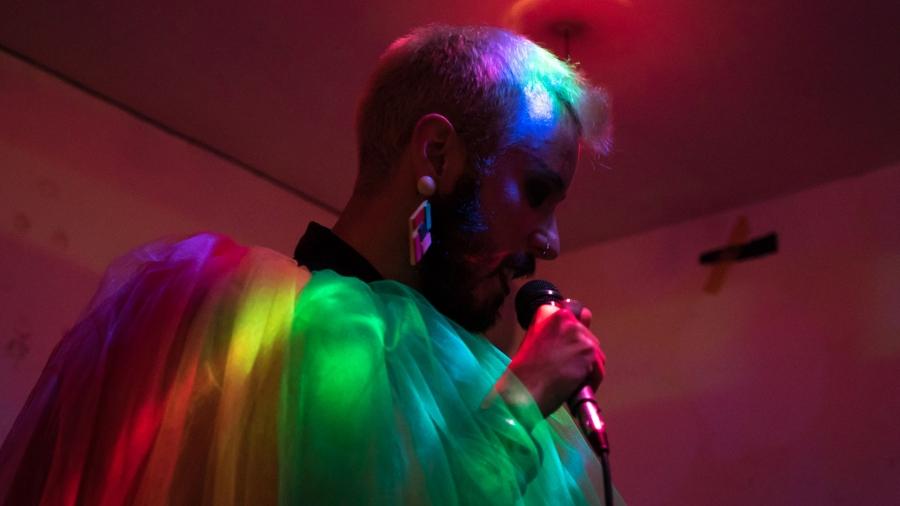 Tiago Lila dressed in a rainbow cloak