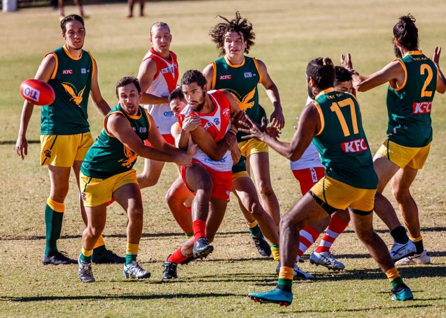A ball is thrown in game of Australian Rules Football taking place in Alice Springs, in Australia's Northern Territory.