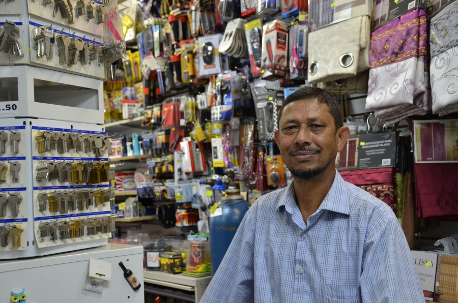 "Rezaul Karim's store, Everyday Super Discounts, is located in the neighborhood widely known as ""Banglatown."""