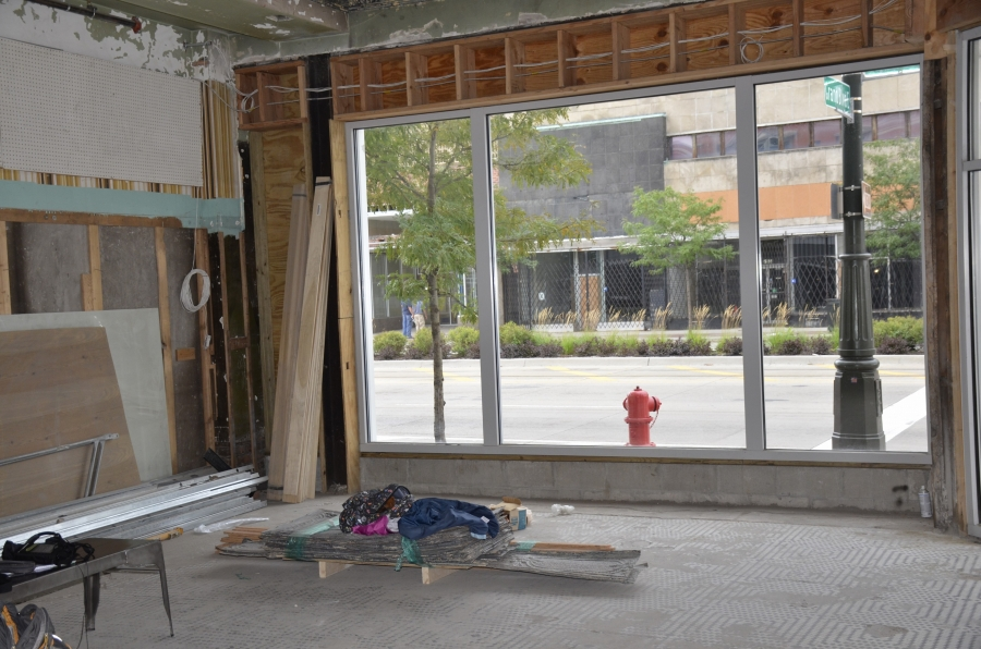 "The view from inside Baobab Fare. The group Motor City Match is investing in several companies in the neighbourhood to try and build density. These few blocks called ""New Center"" were once the corporate home to General Motors, an area of immense wealth."