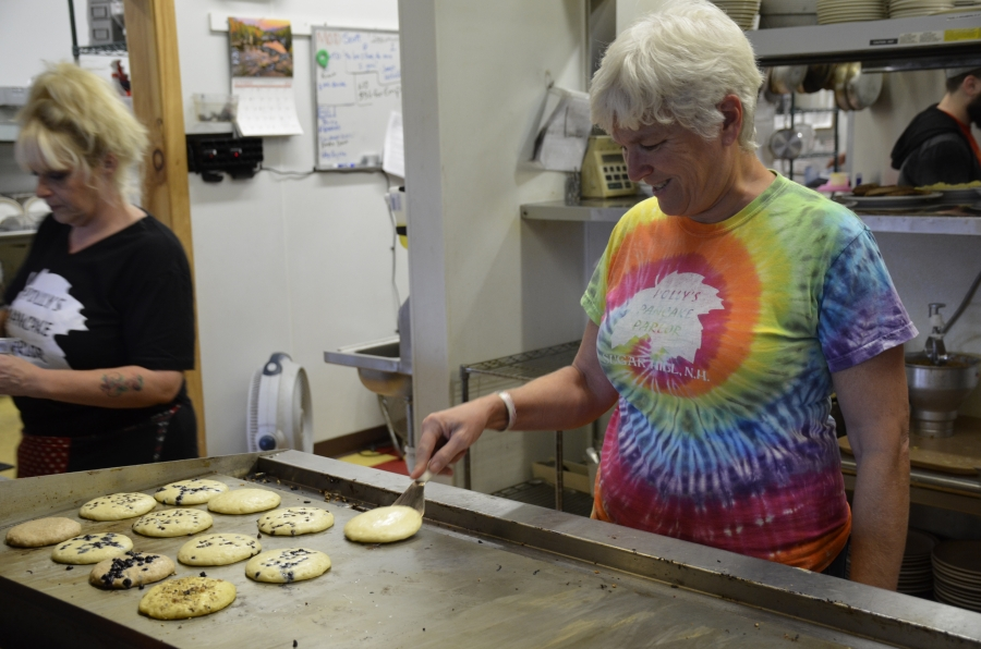 Kathie Aldrich Côté, owner of Polly's Pancake Parlor, grills up pancakes prepared from homemade batter recipes.