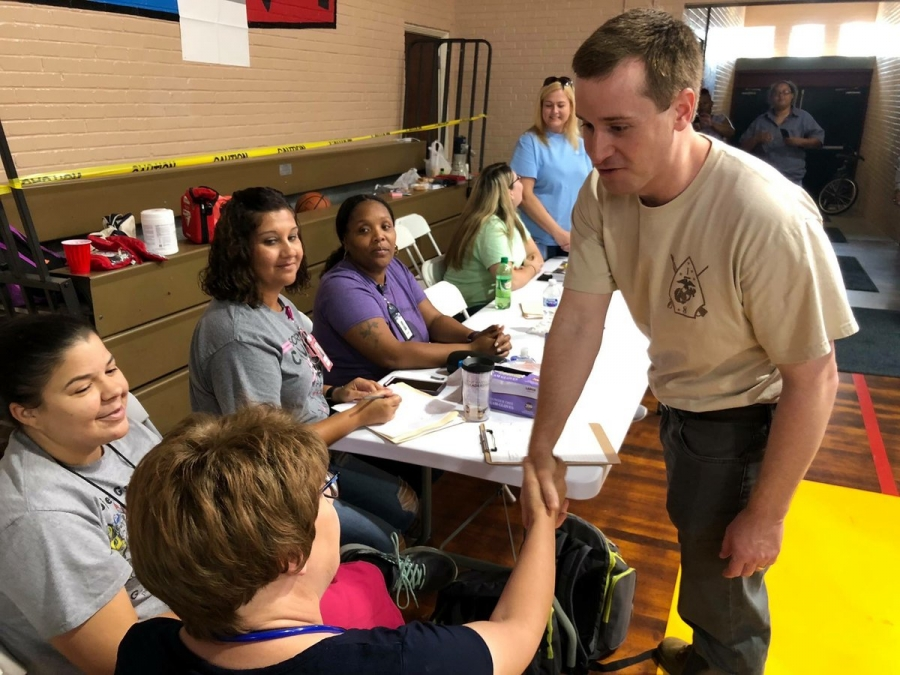 a politican works the crowd at a shelter