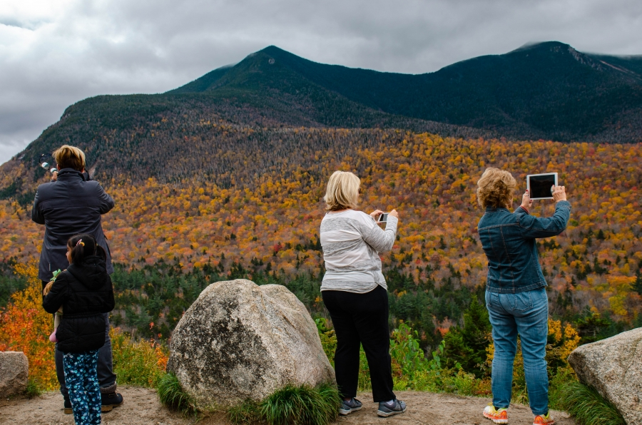 The 34-mile Kancamagus Highway, a path cut through New Hampshire's White Mountain National Forest, is one of the most popular leaf peeping spots in New England.