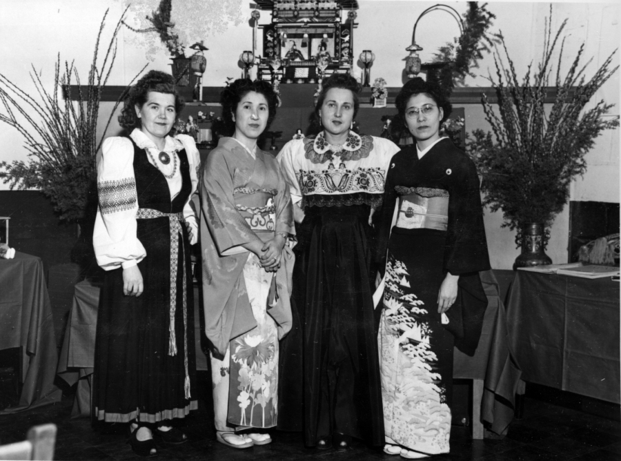 Four women, ornately dressed, two in Japanese dress and two Estonian. Black and white photo