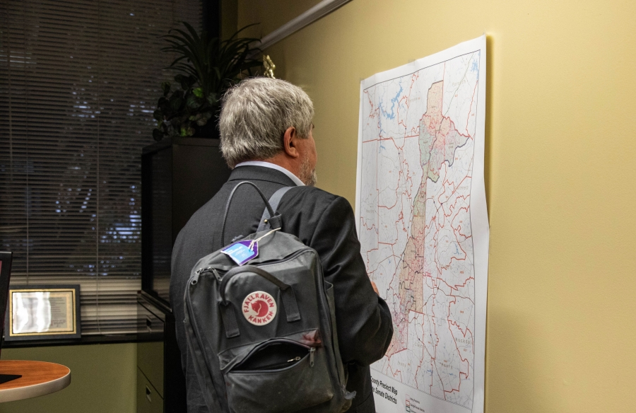 A man inspects a map of Georgia's voting districts.