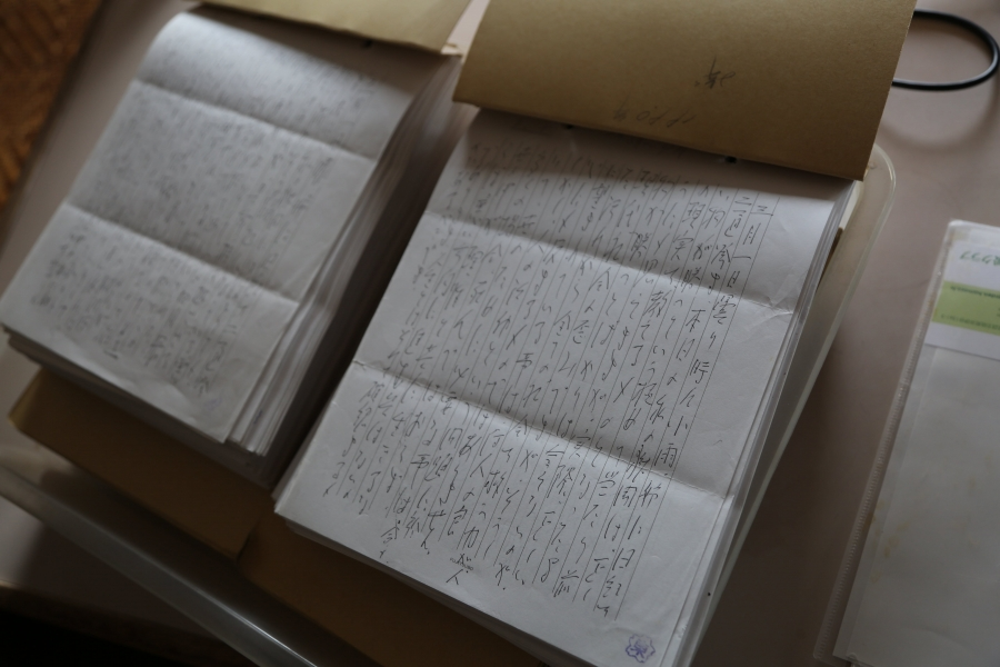 several pages of paper with letters in Japanese