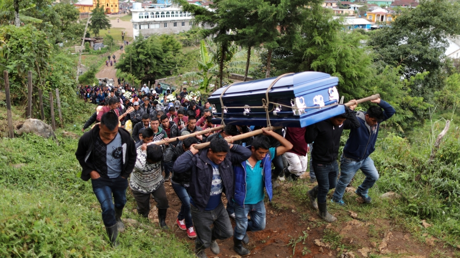 Pallbearers carry Misael Paiz's coffin.