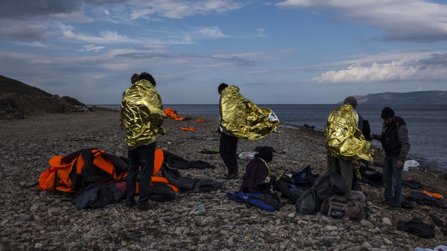 Refugees wrapped in gold reflective blankets to stay warm.