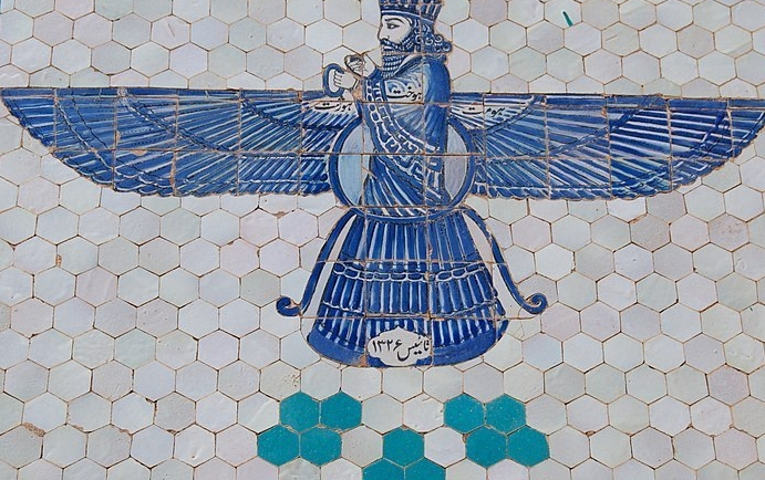 A glazed blue tile depiction of Zoroastrian god Ahura Mazda with blue wings.