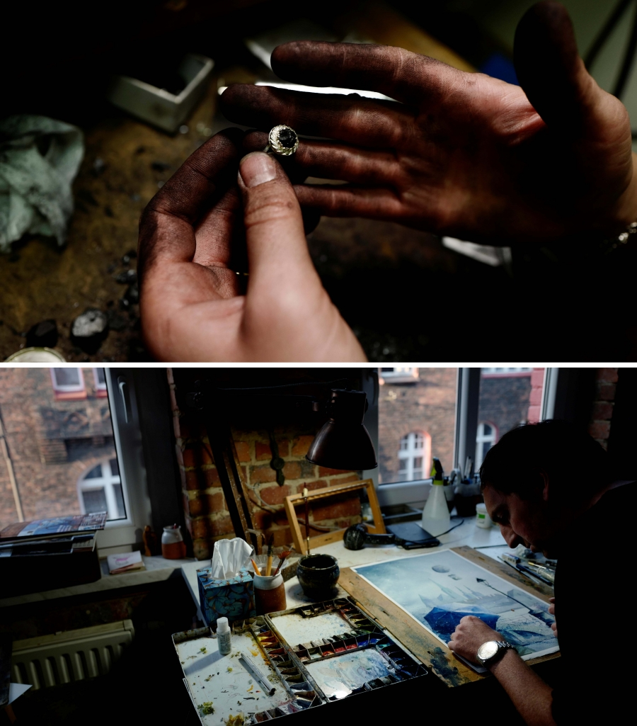 Above: Hands stained with coal hold a silver ring that has a piece of coal as the center stone. Below: A man works on a canvas near a window looking on to brick buildings.