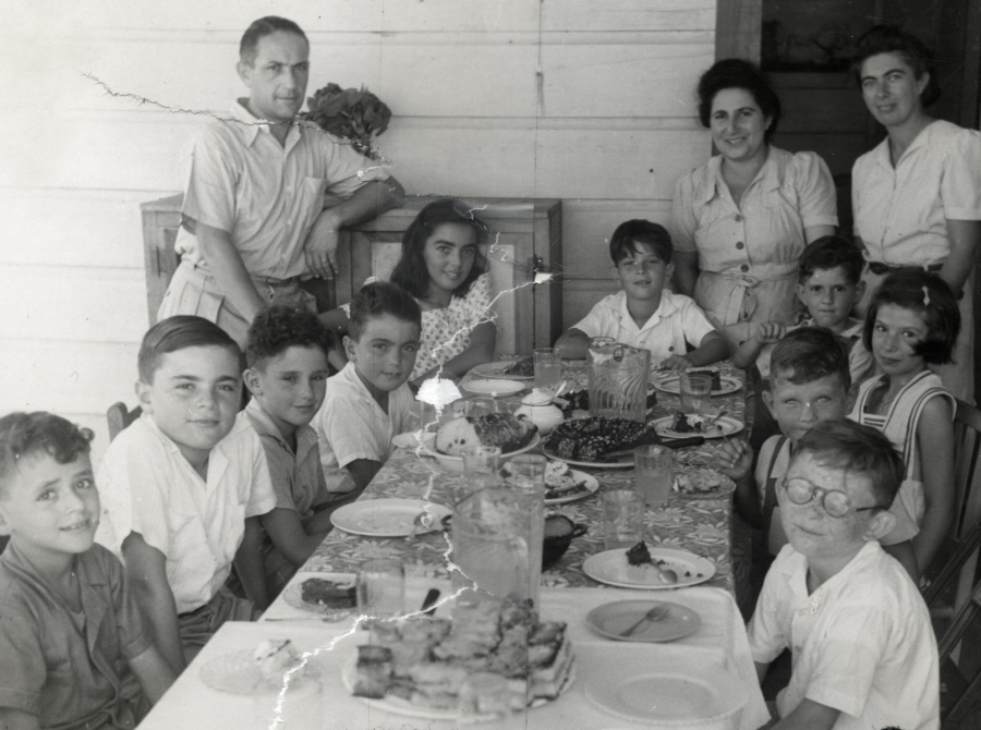 School children sit down for a meal in the Sosúa refugee colony.
