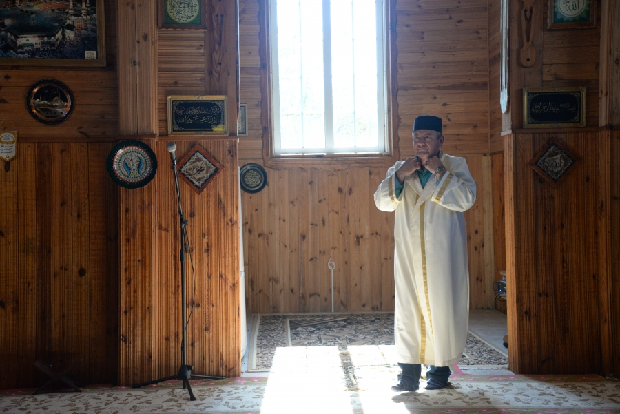 Man in mosque wearing robe