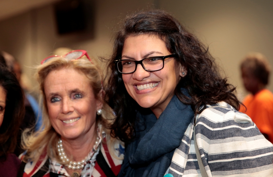 Representative-elect Rashida Tlaib, right, poses for a photograph with US Democratic Congresswoman Debbie Dingell smile with their arms around each other
