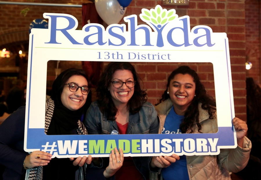 "Three woman stand in Instagram-style frame that reads: ""Rashida 13th District #wemadehistory"""