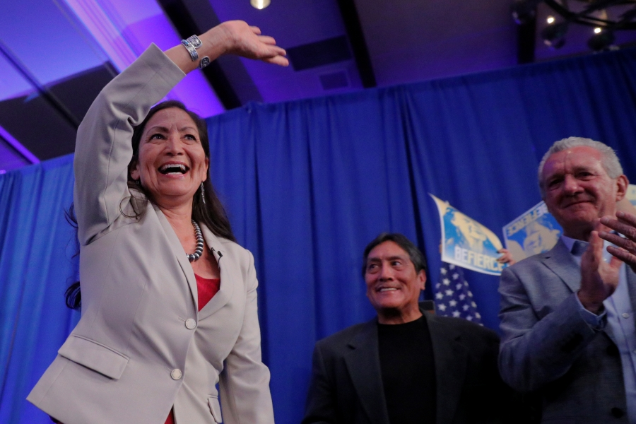 Deb Haaland smiles and waves