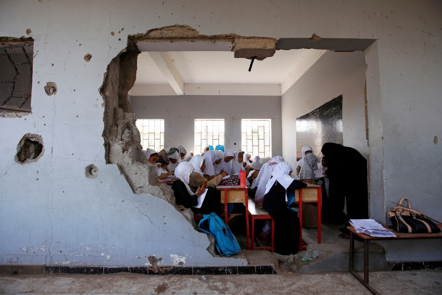 Girls attend a class at their school, damaged by a recent Saudi-led air strike, in the Red Sea port city of Hodeidah, Yemen October 24, 2017