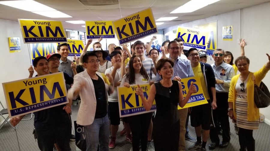 Young Kim, the firstKoreanAmerican woman elected to USCongress stands with supporters in a Facebook photo on her campaign page.