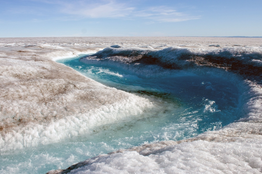 A river of fresh icemelt carves its way through the Greenland ice sheet.