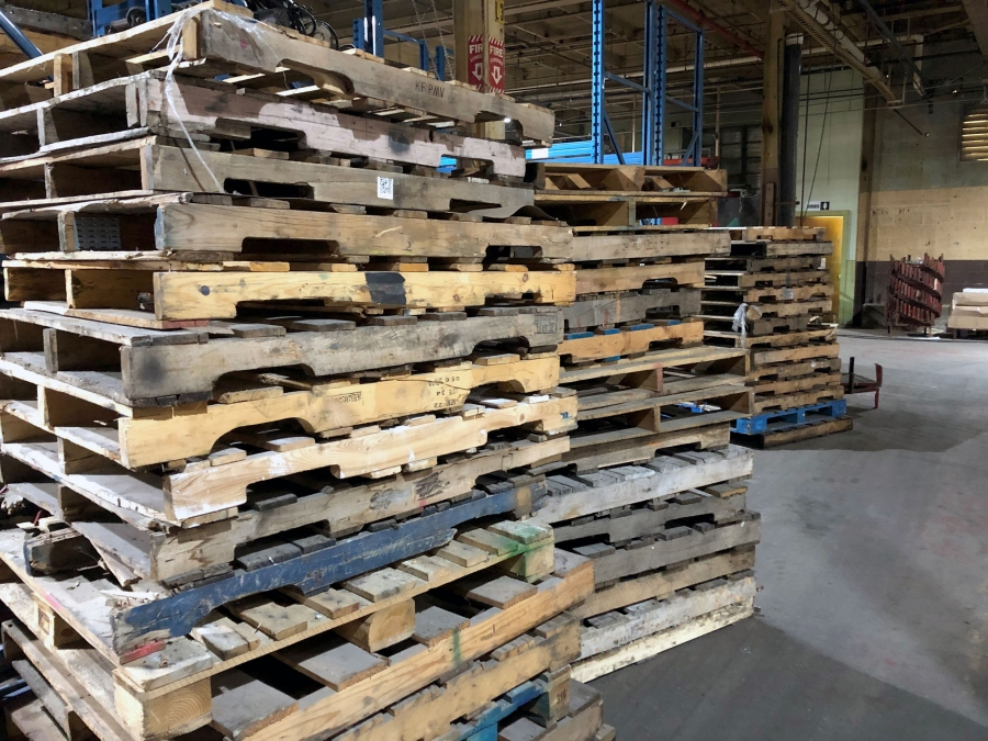 Wooden shipping pallets stacked high.