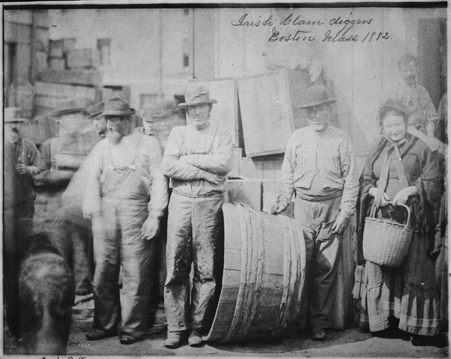 Bearded Irish clam diggers and a matronly companion. A black and white photo from 1882.