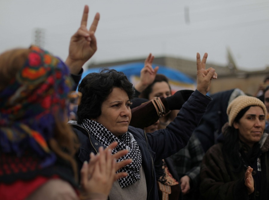 A woman gestures during a protest