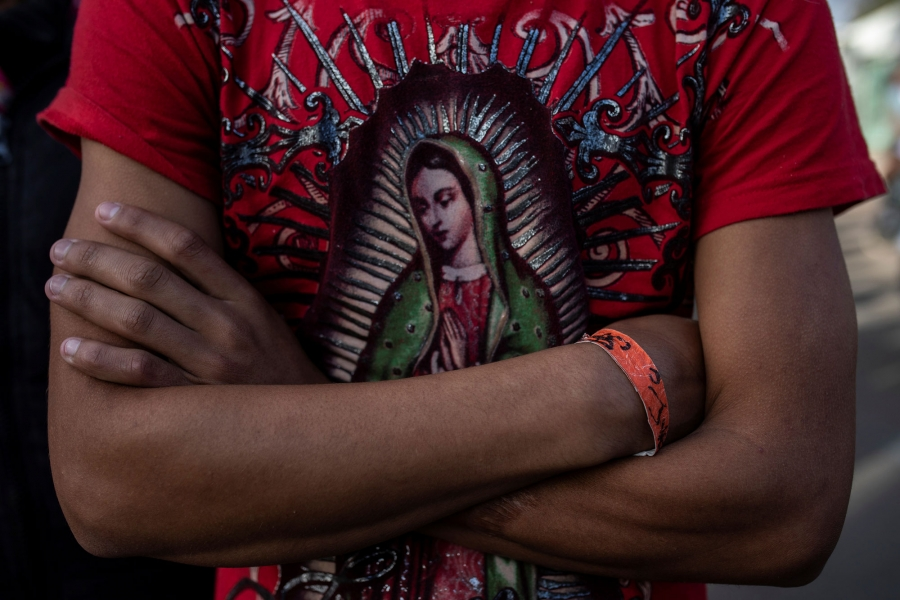 Herso is shown wearing a red t-shirt depicting the Virgin of Guadalupe.