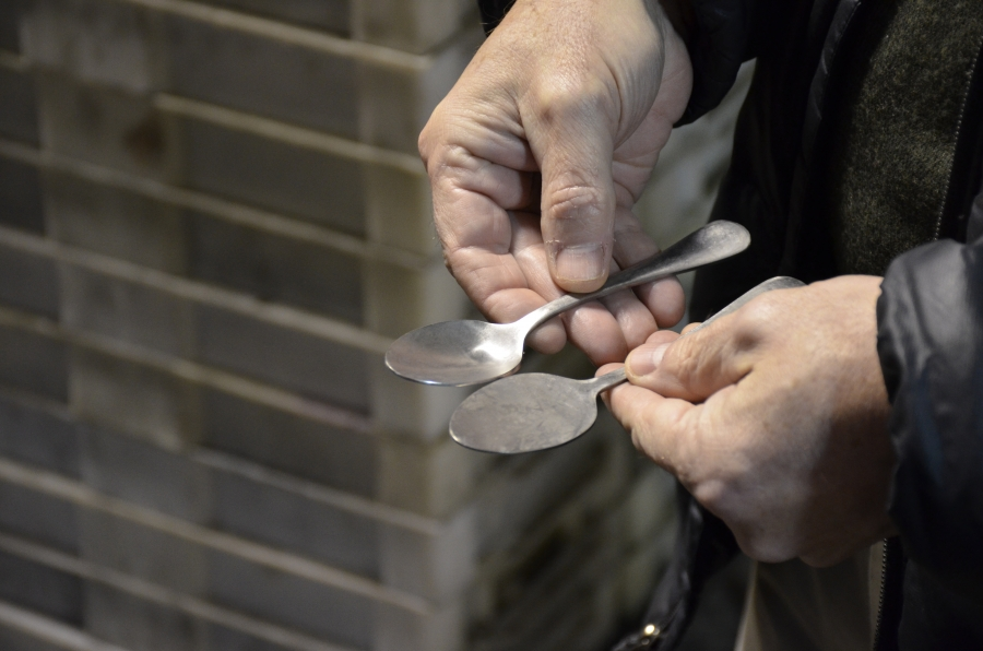 "Greg Owens, CEO of Liberty Tabletop, holds two spoons at various stages of the production process in Sherrill, New York. The upstate New York city is nicknamed ""The Silver City."""