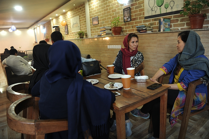 Young men and women enjoy an afternoon at the ICafe in Kabul, Afghanistan.