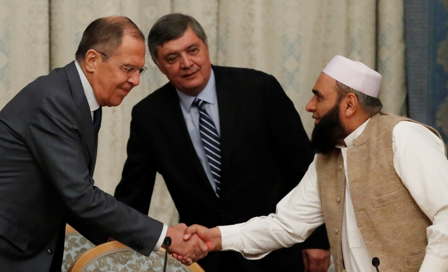Russian Foreign Minister Sergei Lavrov welcomes member of Taliban delegation Alhaj Mohammad Sohail Shaina during the multilateral peace talks on Afghanistan in Moscow, Russia November 9, 2018.