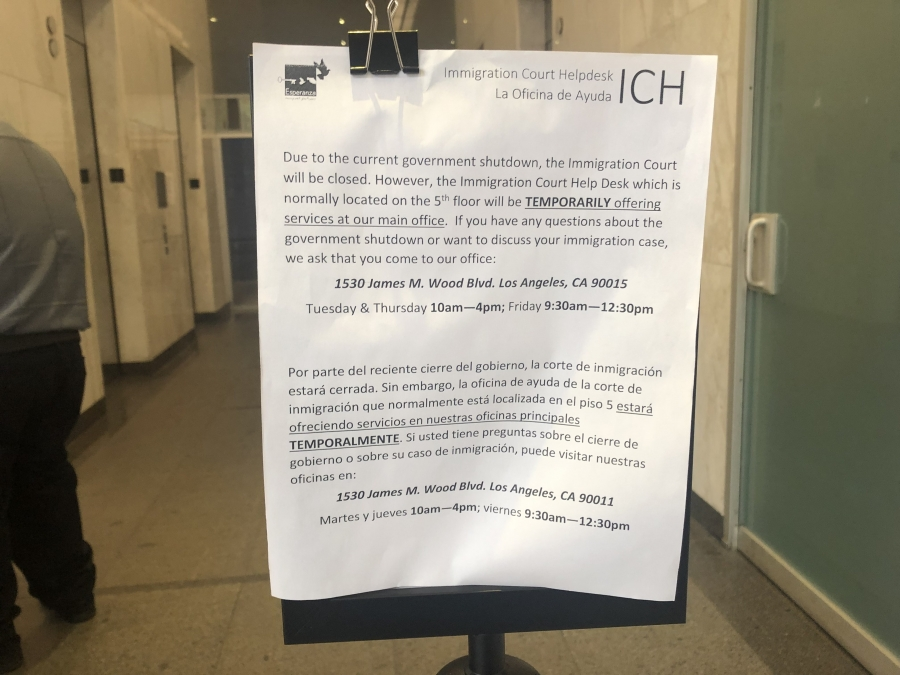 A sign in the lobby of the Los Angeles immigration court explains the court is closed due to a partial government shutdown.