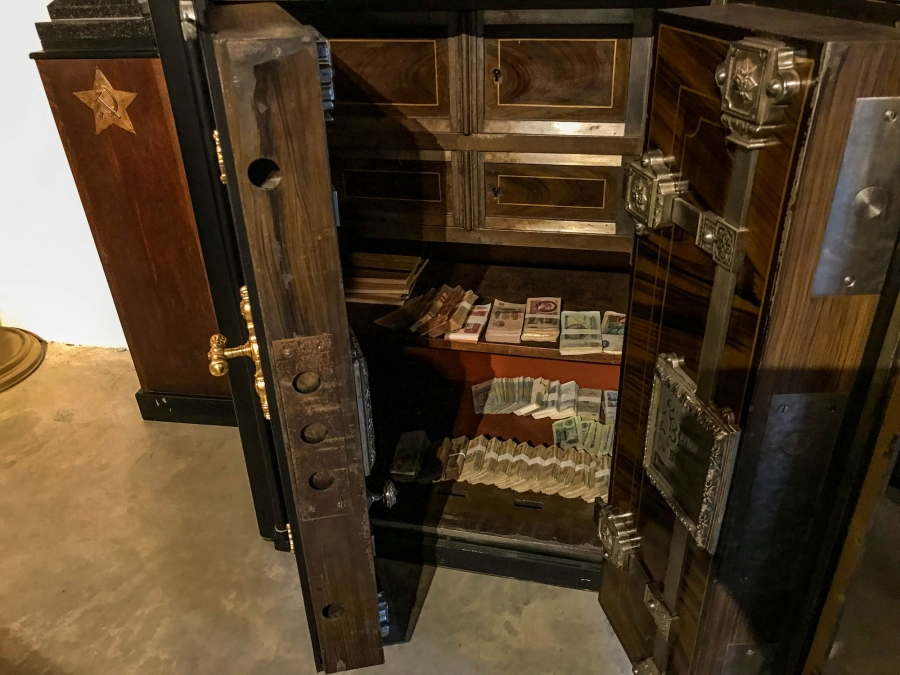 A safe is shown filed with 140,000 in Soviet-era rubles.