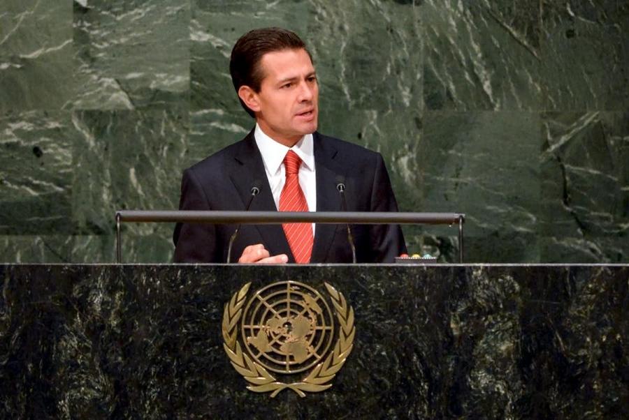 Former Mexican President Enrique Peña Nieto delivers a speech at a podium