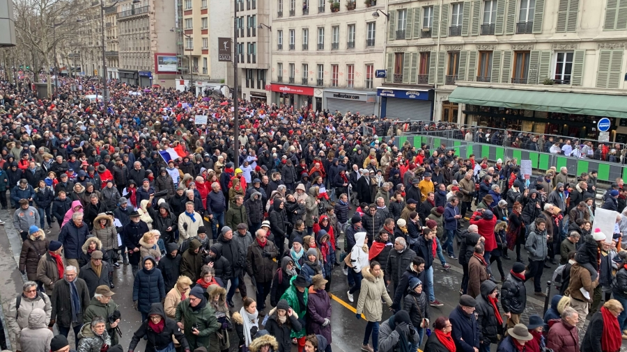 Thousands of people march wearing 'red scarves' against yellow vest movement.