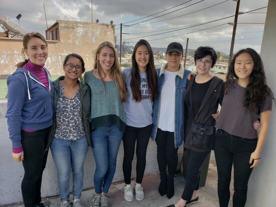 Seven university students pose for the camera