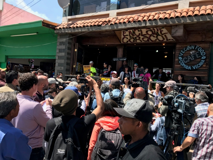 A crowd in front of a cafe