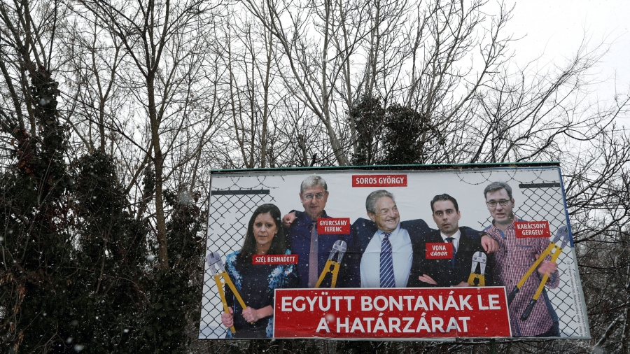 A billboard shows billionaire George Soros and other Hungarian opposition leaders.