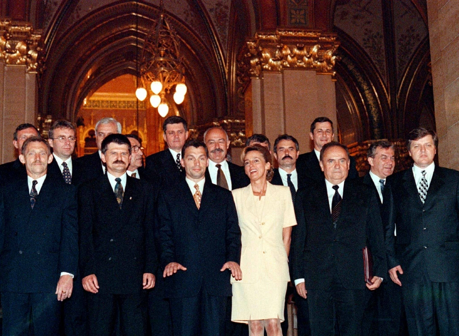 Government officials pose around Viktor Orbán in a group photo. There is only one woman in the group.