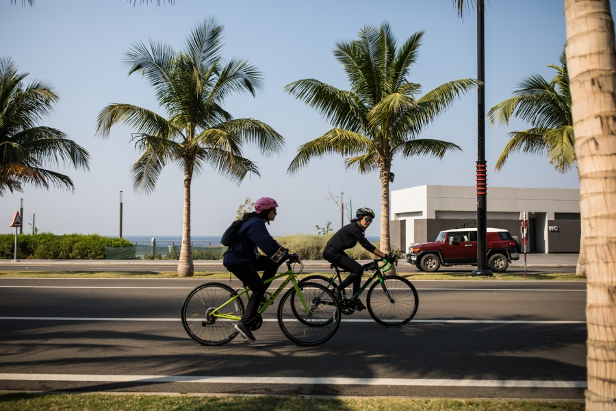 Doaa Naeem and her sister Fatimah Naeem ride their bikes in Jeddah, Saudi Arabia.
