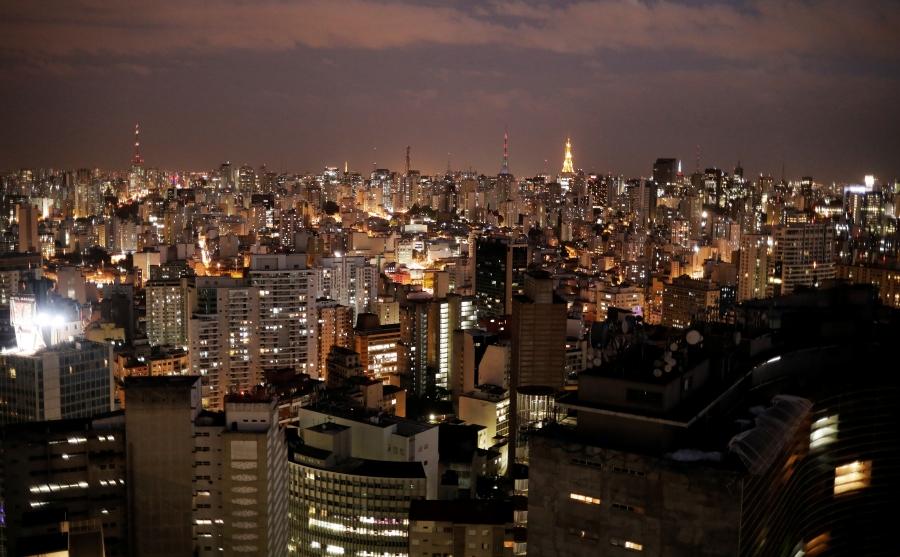 A dense cityscape at night