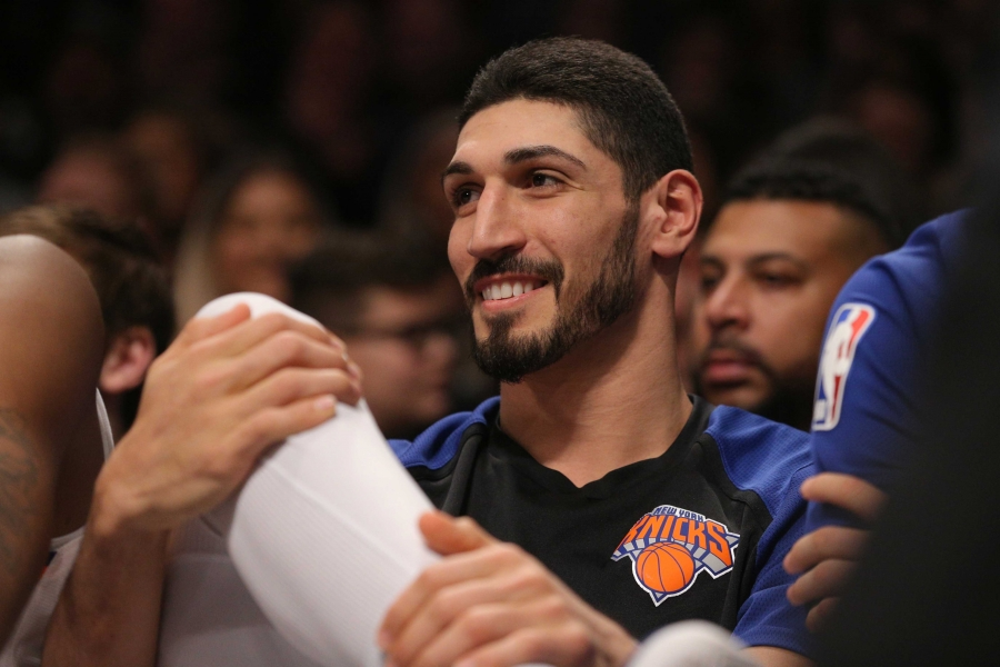 A close up of Enes Kanter's face as he looks to the left