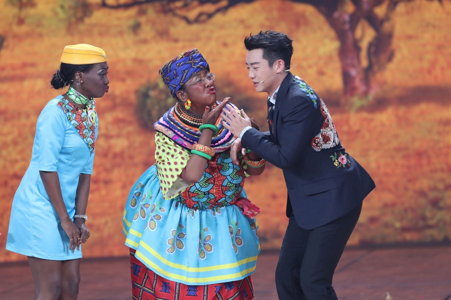 Chinese actor Lou Naiming is shown performs a skit wearing blackface and a colorful dress.