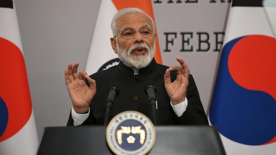 India's Narendra Modi gestures behind a podium