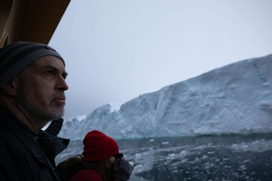 Chief Scientist Rob Larter is shown in the nearground looking out at Thwaites glacier on the morning of arrival.