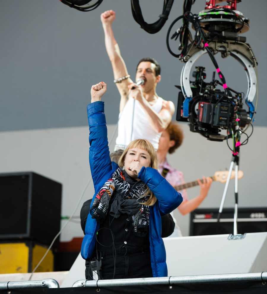 "Movement director Polly Bennett guides Rami Malek during filming for ""Bohemian Rhapsody."""