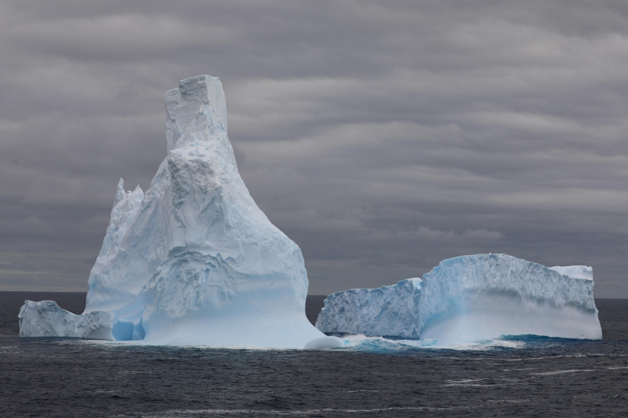 Tall white iceberg recedes to the stern of the Nathaniel B. Palmer.
