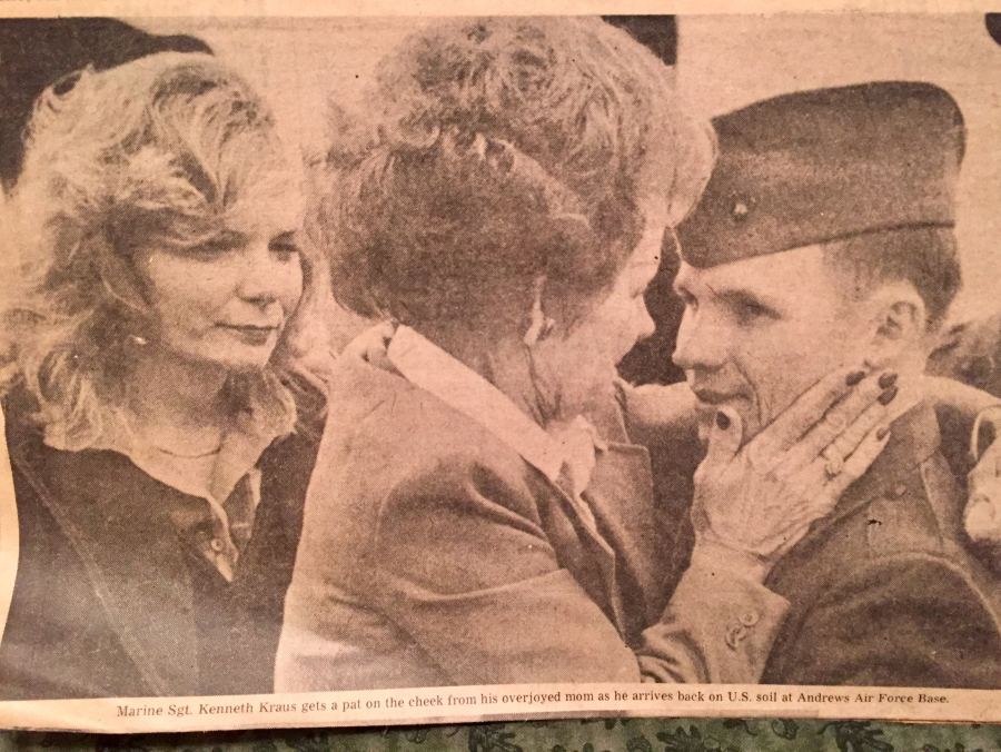 Marine Sgt. Kenneth Kraus gets a pat on the cheek from his overjoyed mom