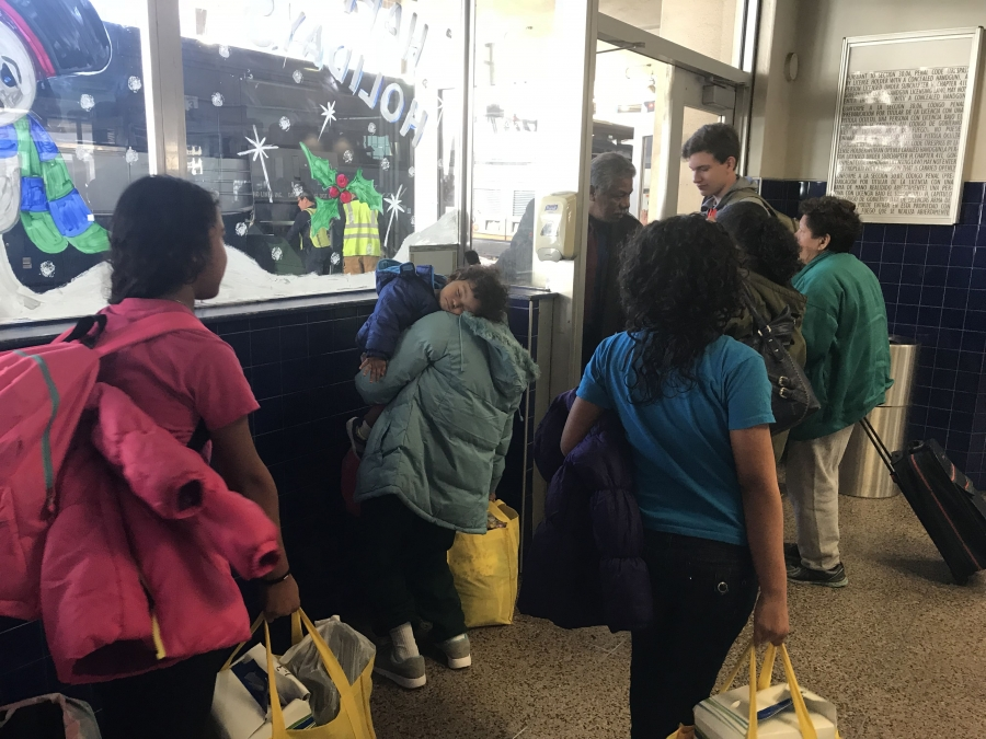 Migrants just released from detention at a Greyhound bus station in San Antonio
